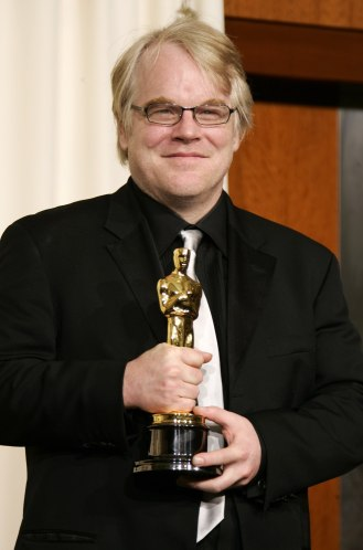 File photo of best actor winner Hoffman with Oscar at the 78th annual Academy Awards in Hollywood